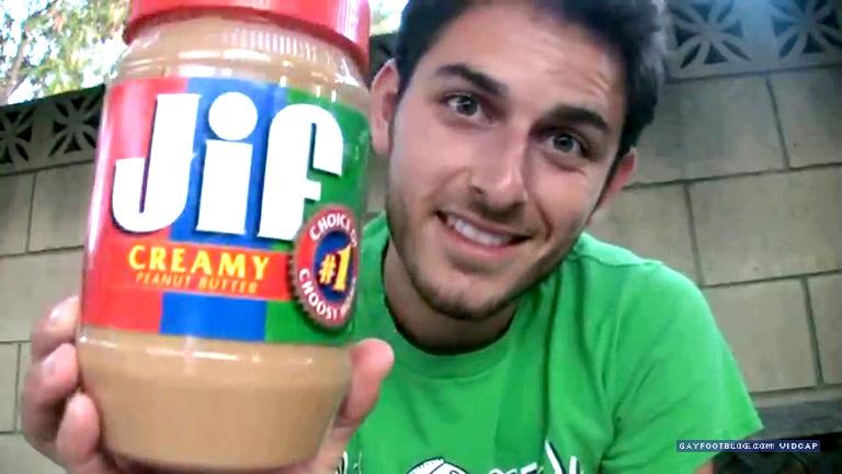 dog licks peanut butter off of feet