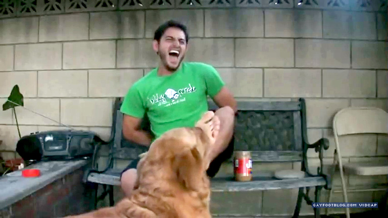dog licks guy's bare foot