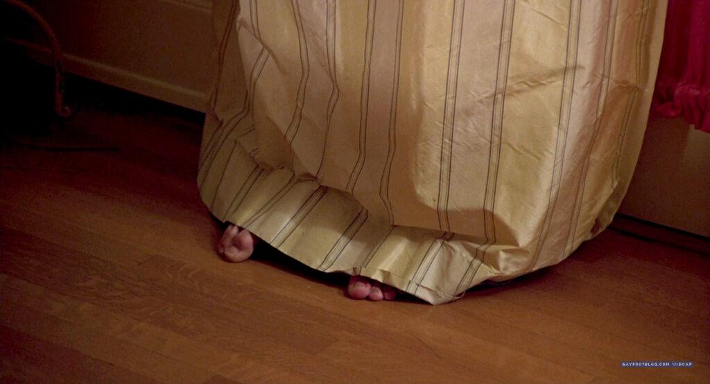 ashton's toes behind a curtain
