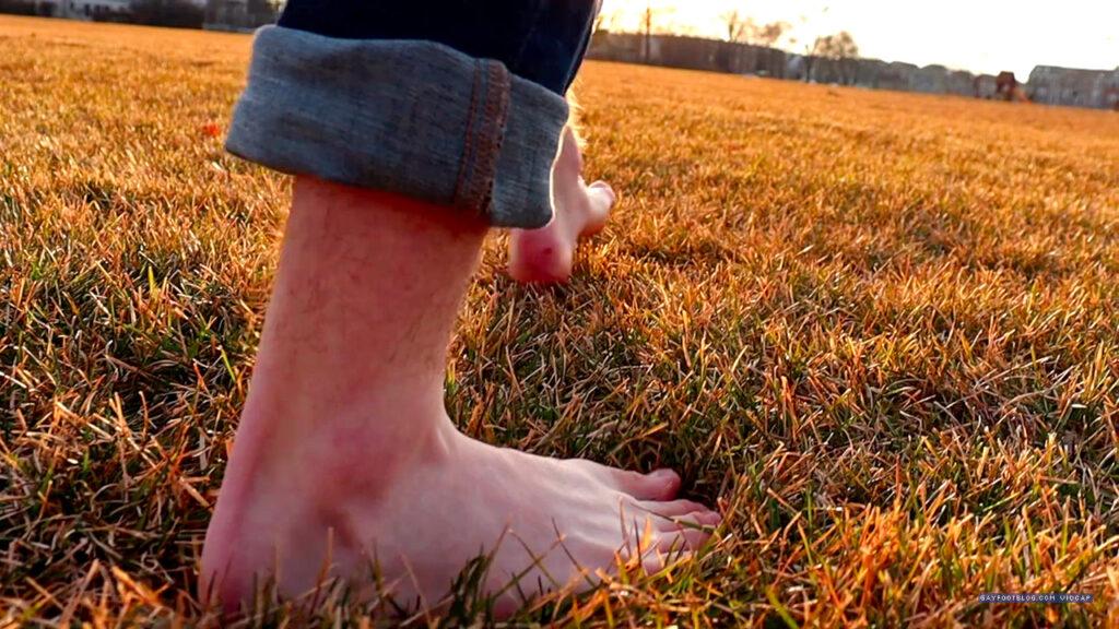 Colin's feet in a field