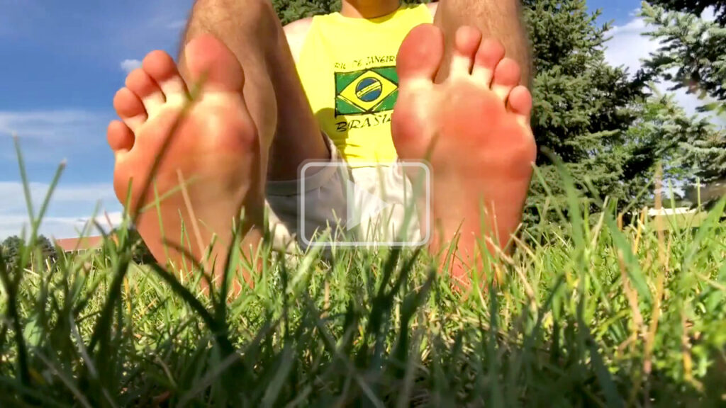 twink feet in the grass