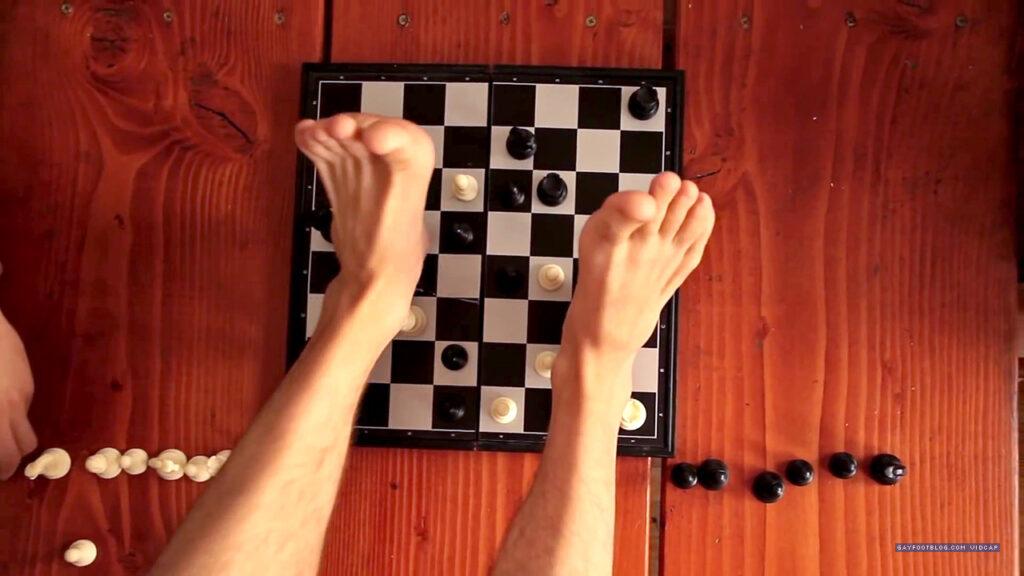 Thomas's feet on the chess board
