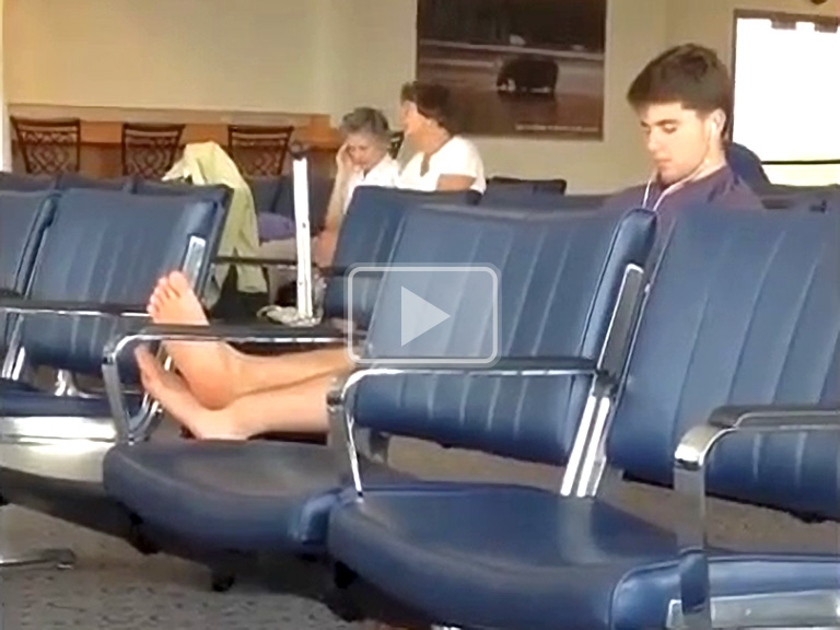 twink airs out bare feet in public at airport